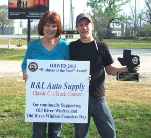 "John Farley, Manager of R&L Auto Supply in Old River-Winfree received the ORWFD 2013 ""Business of the Year"" Award from Colleen Fontenot, ORWFD President and Old River-Winfree City Council member"