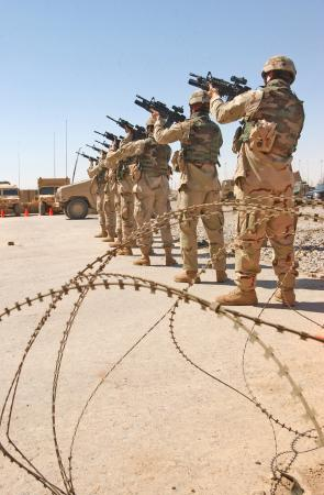 The seven-man firing party fires the first series of rounds in a volley of 21 in honor of Pfc. Wesley R. Riggs, Task Force 2-7 Infantry, 3rd Infantry Division. Riggs was killed in action May 17, 2005 in Mukasheefah, Iraq.