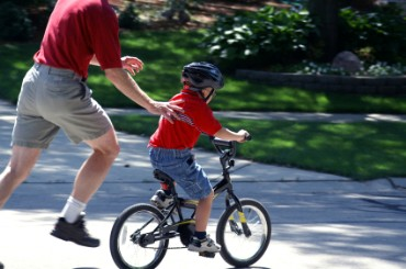 fathers_day_father_teaching his son riding bicycle caring father running behind son love between father and son lovable dad a poem dedicated to father on father's day song dedicated to dad